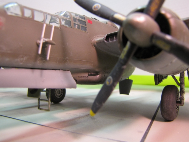 The main battery, four 20 mm cannon in the belly behind the nose gear