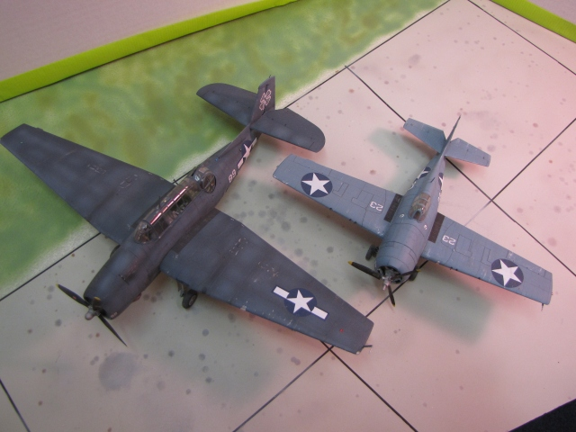 Two Grumman products.  The family resemblance is obvious.