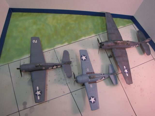 The whole family of World War II Grumman carrier aircraft.  From left to right; Hellcat, Wildcat and Avenger.