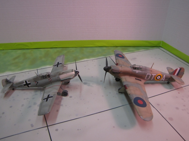 Battle of Britain rivals.  Notice the size difference.  Both aircraft had roughly the same power.  The Messerschmitt was faster and better at altitude.  The Hurricane more stable, more robust and more maneuverable.
