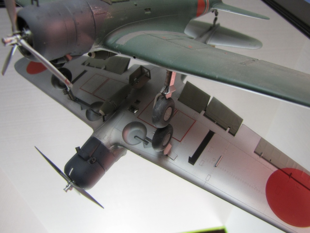 The 800 KG armor piercing bomb.  The bomb aimer's window is alongside the bomb.