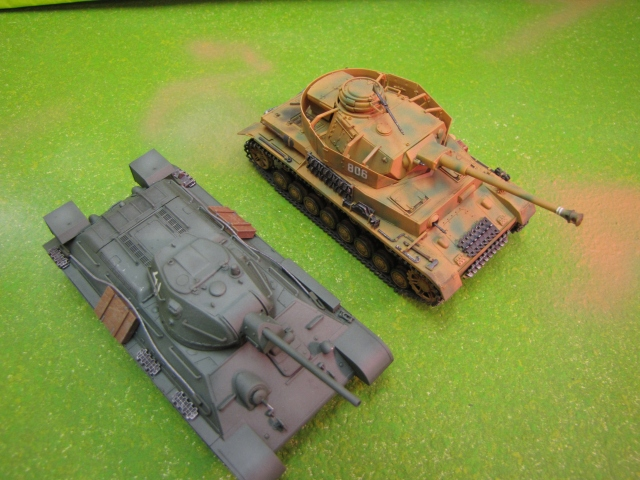 T-34 and Panzer IV.  Two similar tanks in size and capability.  The gun on the Panzer looks bigger than it is because of the muzzle brake at the end. Look how much lower profile the T-34 is, and its thicker tracks allow for better cross country performance. Also the well slopped armor means its less likely to catch a shot square than the Panzer is.