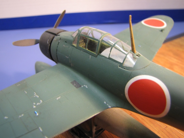 All Rufes were delivered in the early war all grey color.  But in early 1943 this aircraft received a coat of Navy Green camouflage all over, except under the canopy!