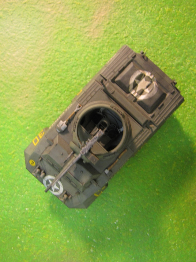 The open turret top is common on armored cars and other light units.  Its obviously a mixed blessing; it aids situational awareness and communication, but is a vulnerability, especially in urban settings.