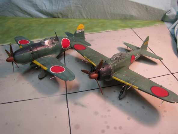 Mitsubishi fighters.  Here the Jack is shown with a late-war Zero, both aircraft served in homeland defense.