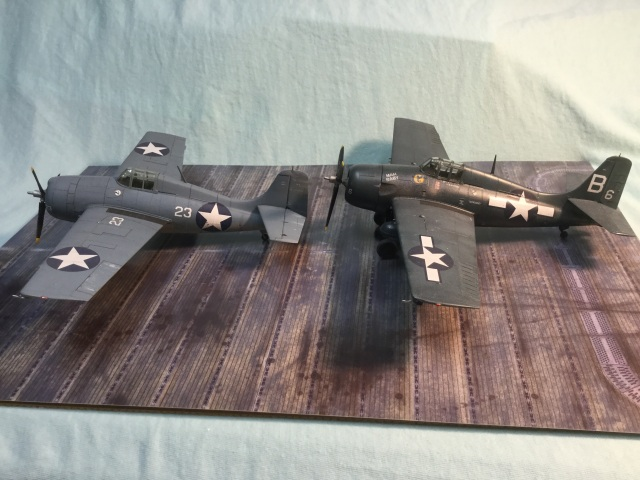 An earlier F4F-4 Wildcat on the left. The FM-2 had a taller tail to counteract greater engine torque. The cockpit should sit a little taller, I don't believe is properly represented by the kit. And the nose should be a little blunter on the FM-2.