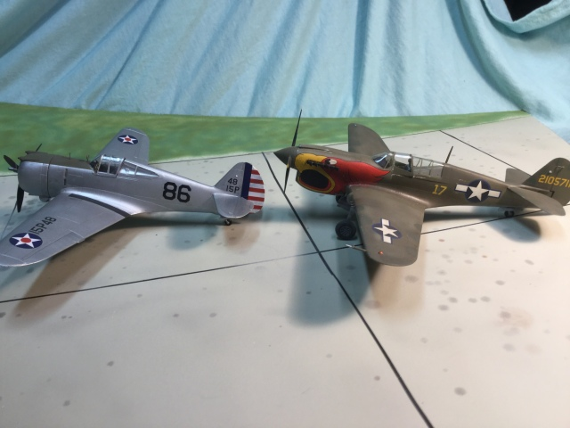 The P-36A with a P-40N. The P-40N was the final production version of the family that started with the P-36. The similarities in the wings and tail are obvious.