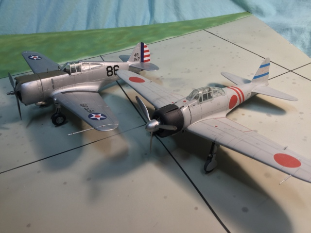 The P-36 and its rival on December 7. The Zero was a more advanced design, but by as much as many suppose. The P-36 was mainly handicapped by the surprise attack and some disparity in pilot skill levels.